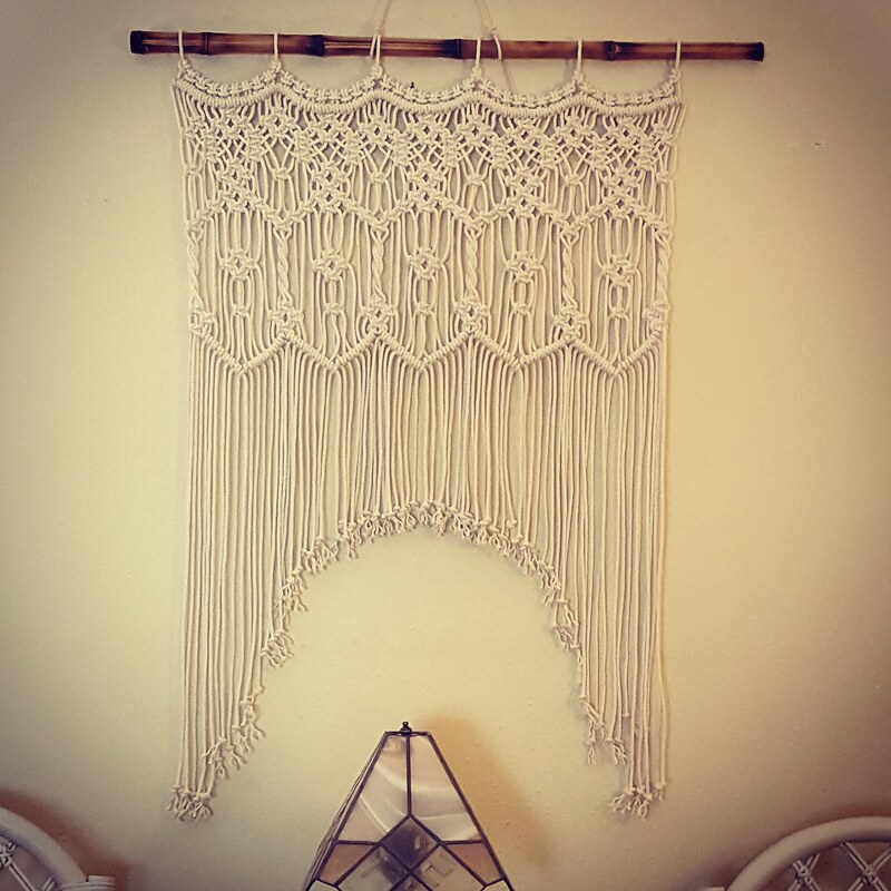 Macrame wall hanging with arch